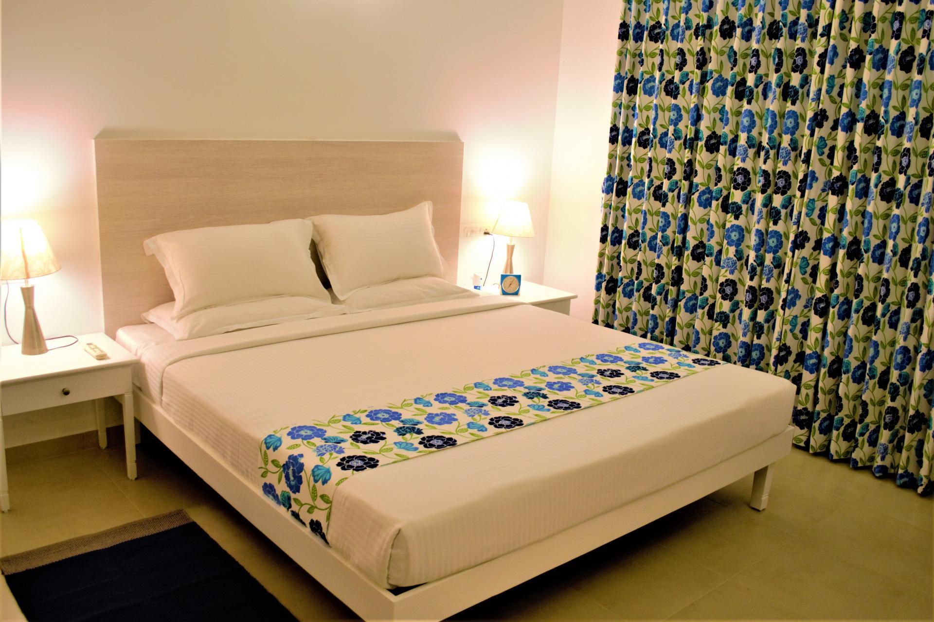 Bedroom at Bhartiya City Apartments