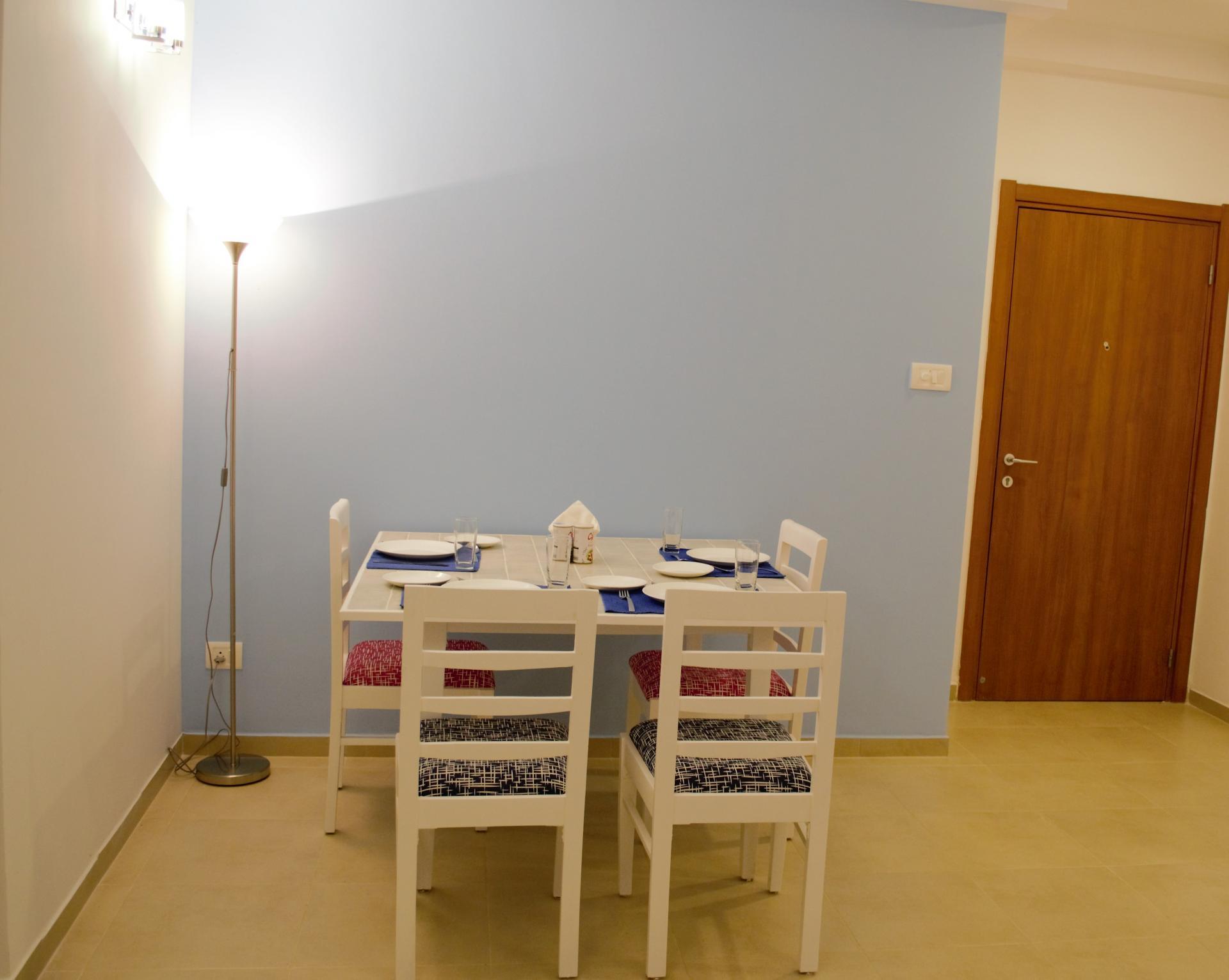 Dining table at Bhartiya City Apartments