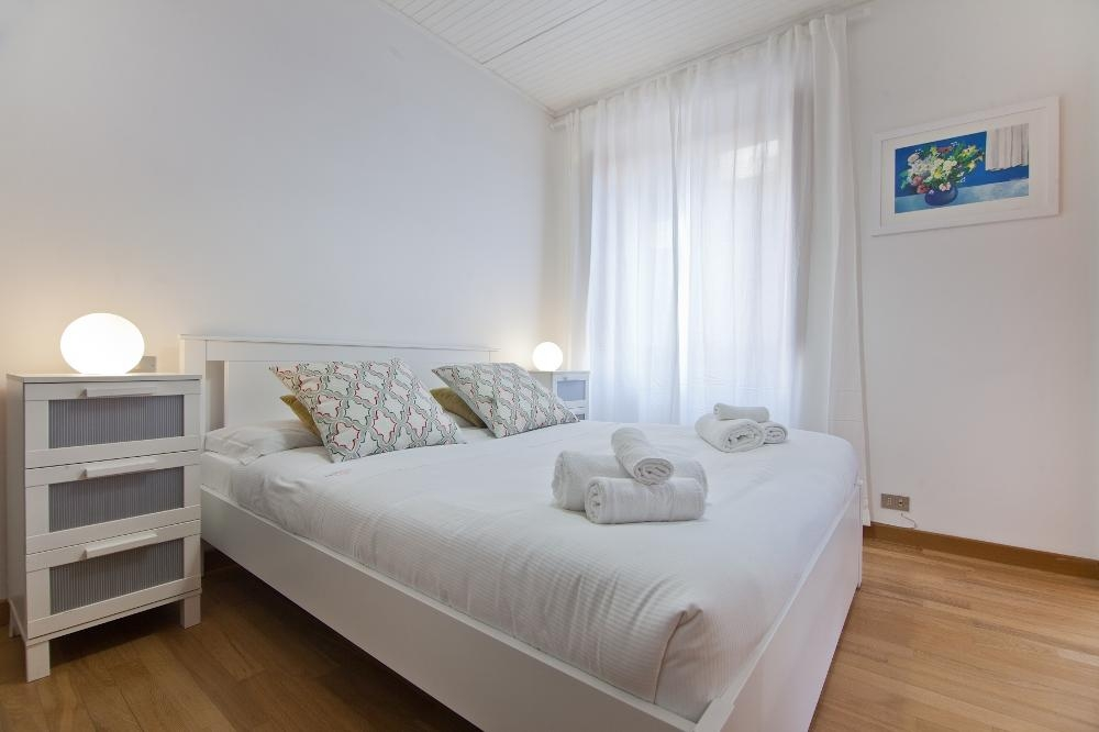 Bed at Flaminia Apartment, Municipio I, Rome