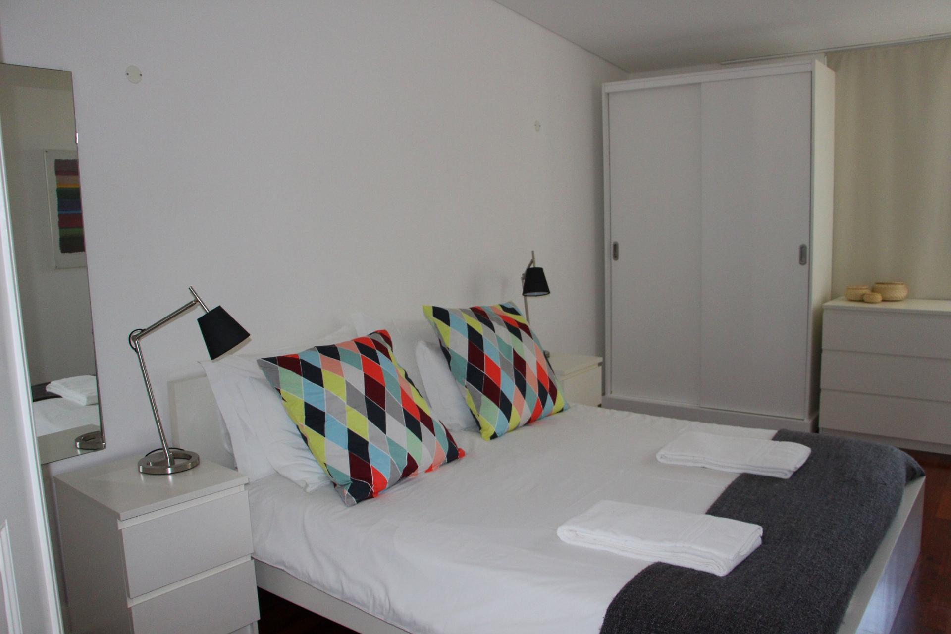 Double bed at Santos River Serviced Apartments