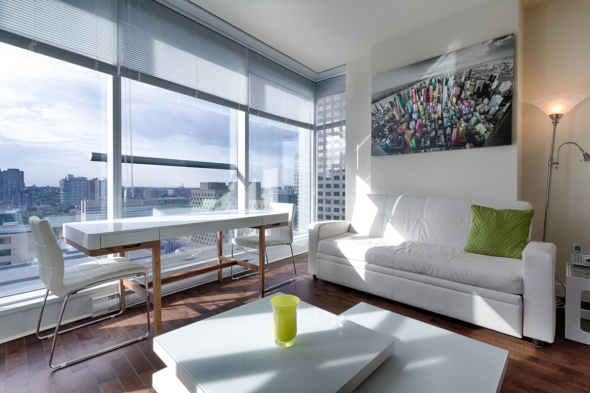 Living room at Le V Serviced Apartments