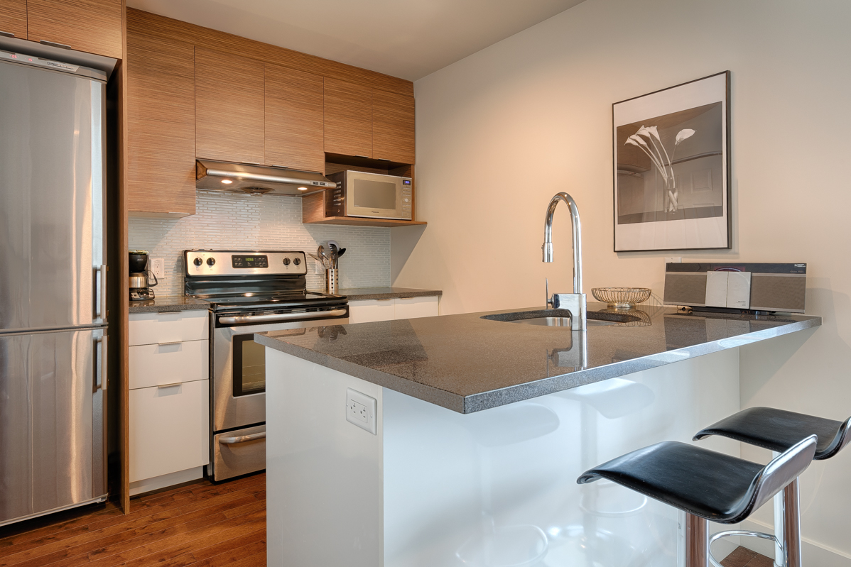 Kitchen at Le V Serviced Apartments