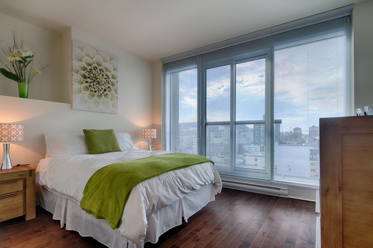 Spacious bedroom at Le V Serviced Apartments