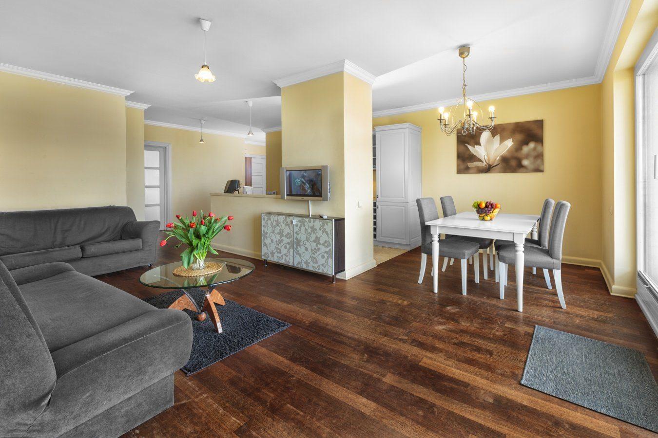 Open-plan living area at Zeligowskiego Apartments