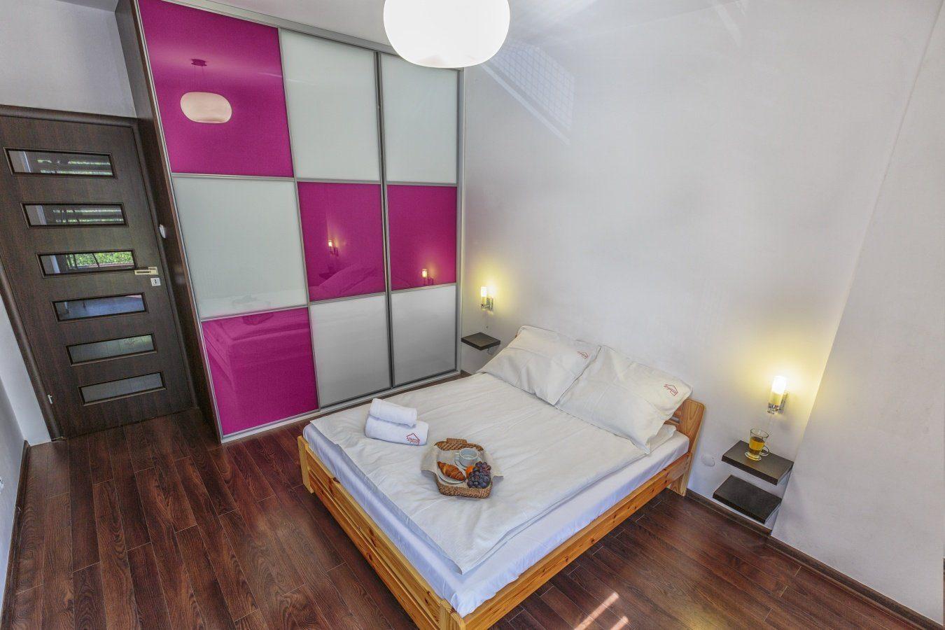 Bedroom at Zeligowskiego Apartments