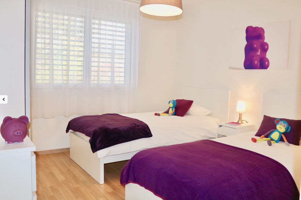 Double bed at St Sulpice Apartments