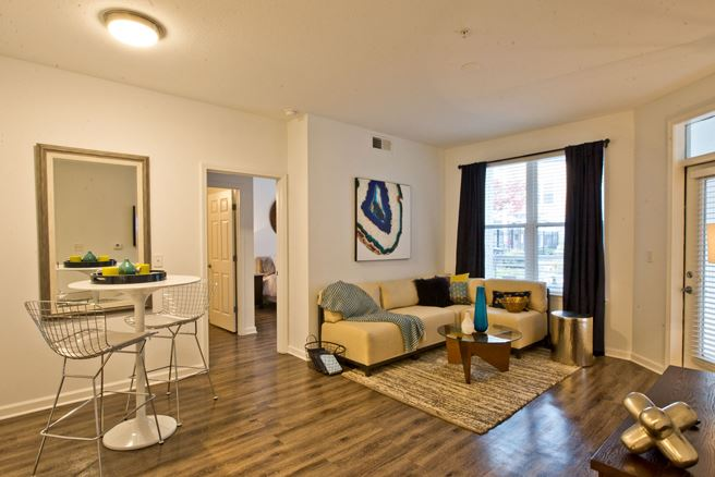Living room at Exchange at Middle Town Apartment