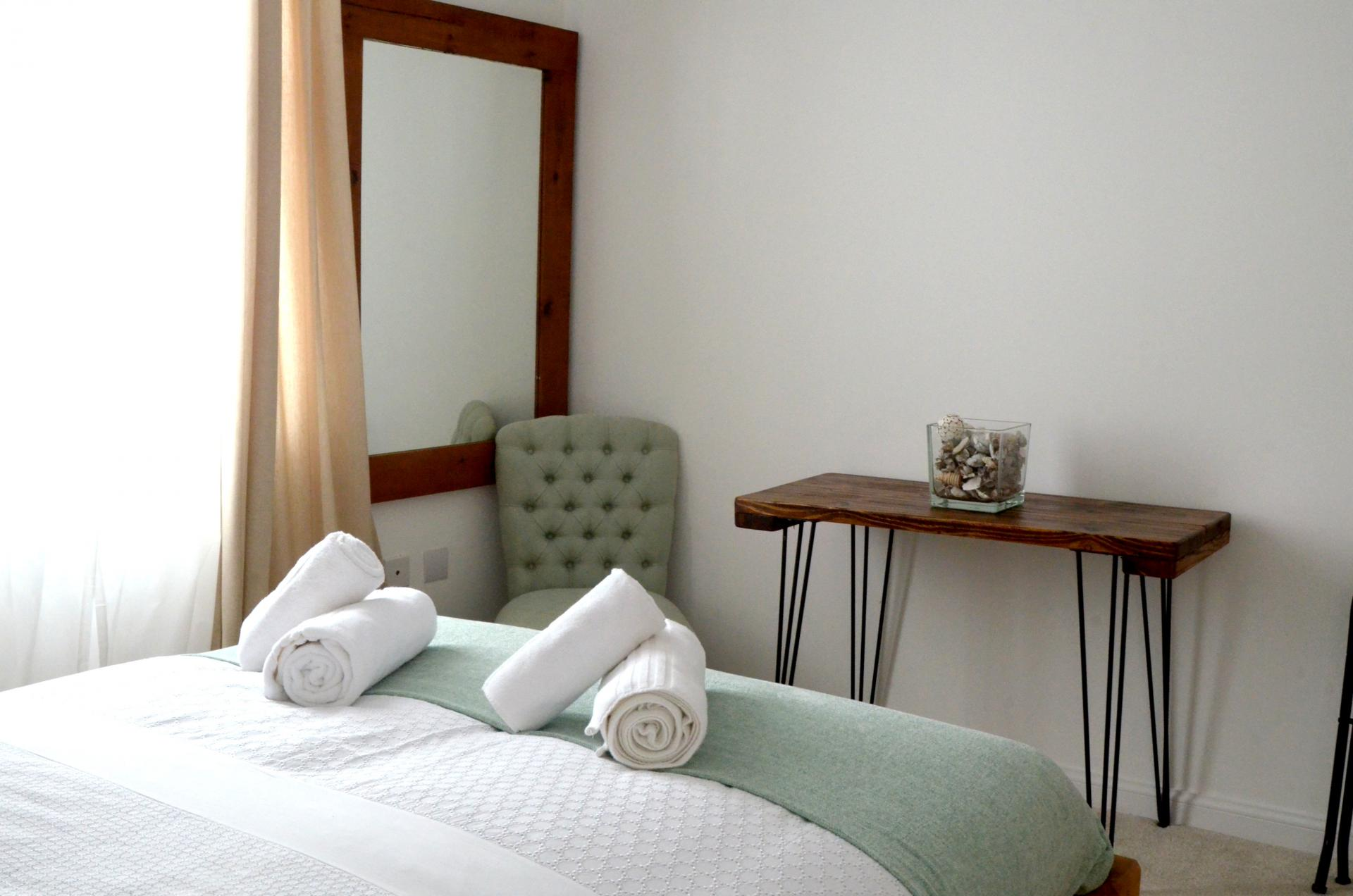 Stylish bedroom at Rosso Close Apartments