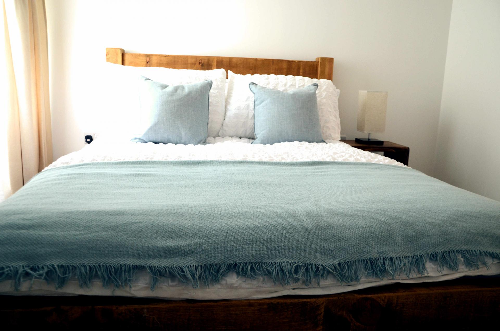 Comfortable bed at Rosso Close Apartments