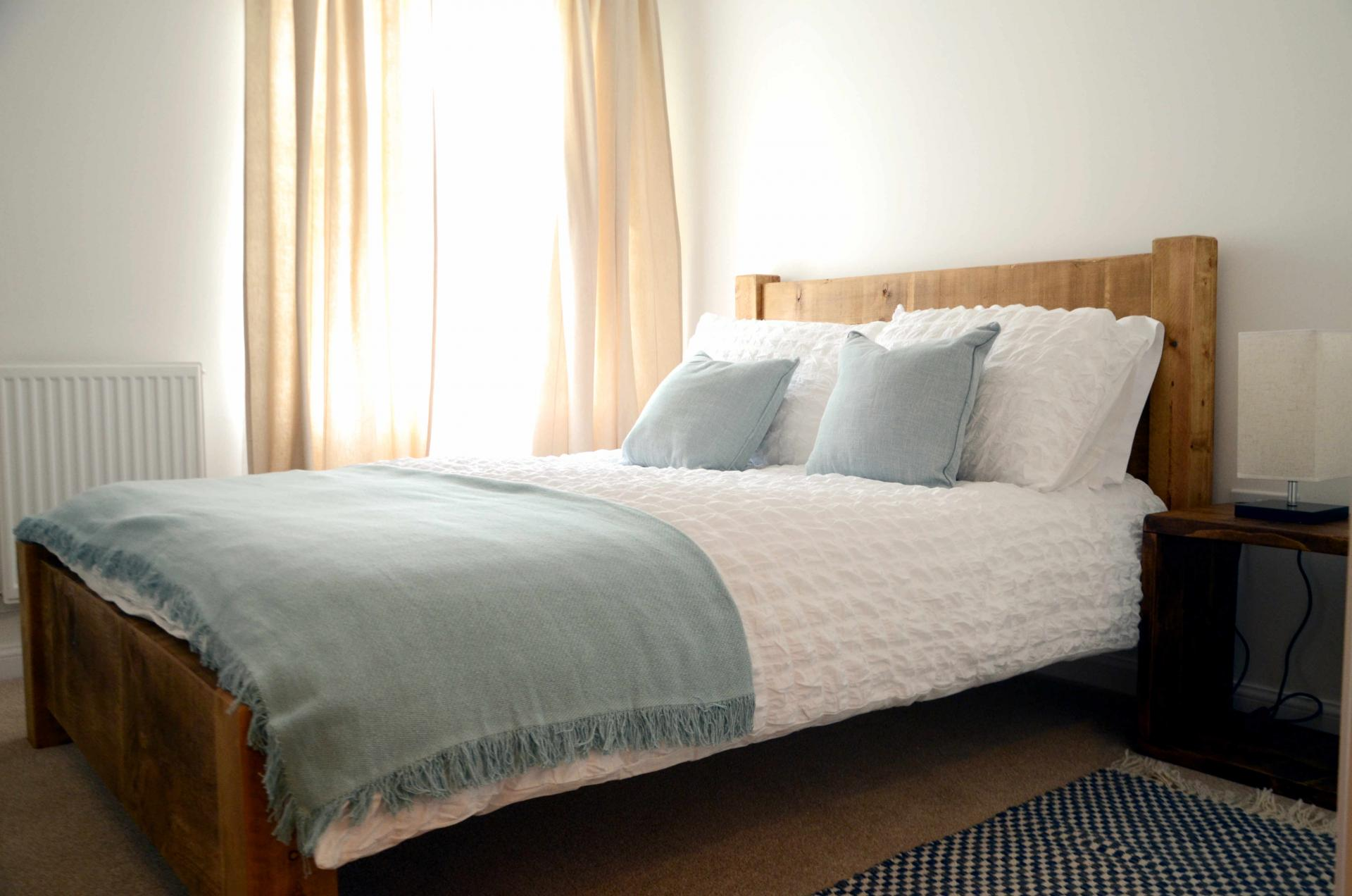 Double bed at Rosso Close Apartments