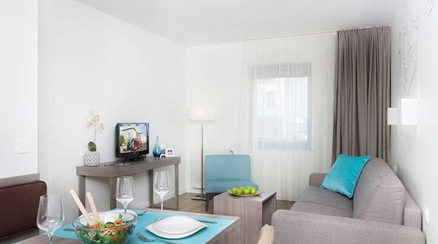 Modern living area in Citadines Toison d'Or Apartments