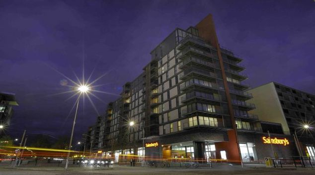 Exterior at night of City Apartments - Vizion