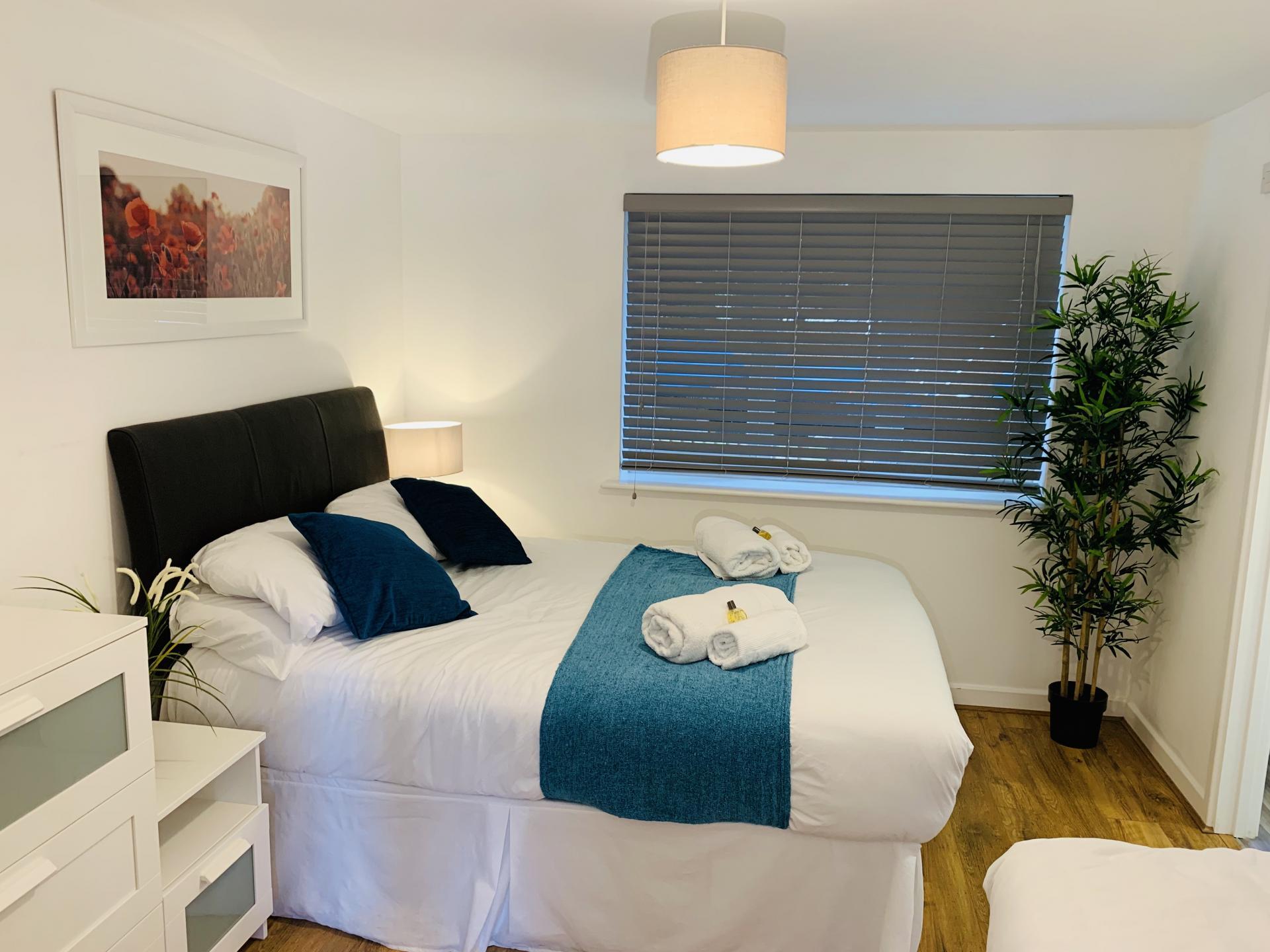 Bed at Barrack Road Apartment