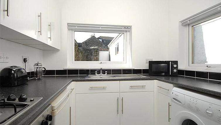 Equipped kitchen at Trafalgar Place Apartment