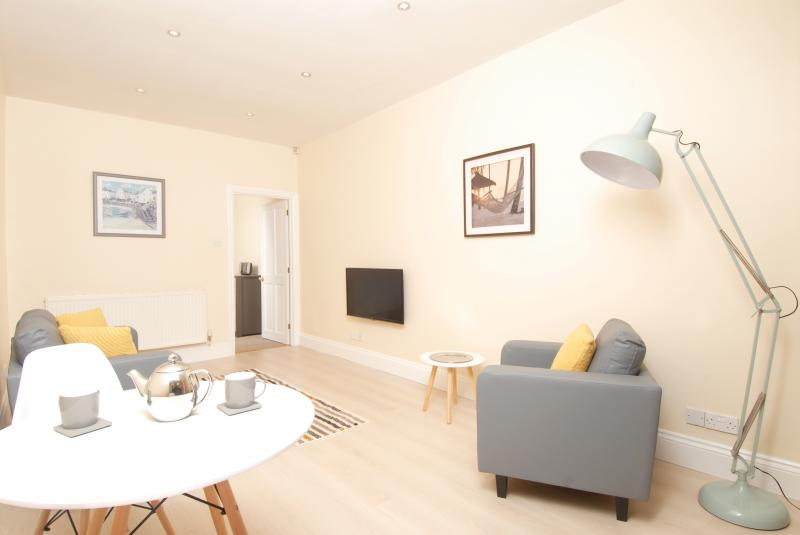 Living and dining area at Trafalgar Place Apartments