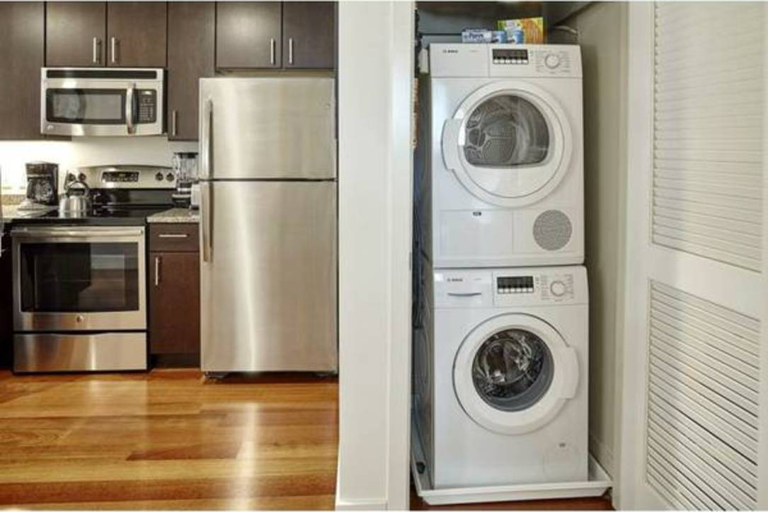 Kitchen and laundry facilities at Aq Rittenhouse Apartment