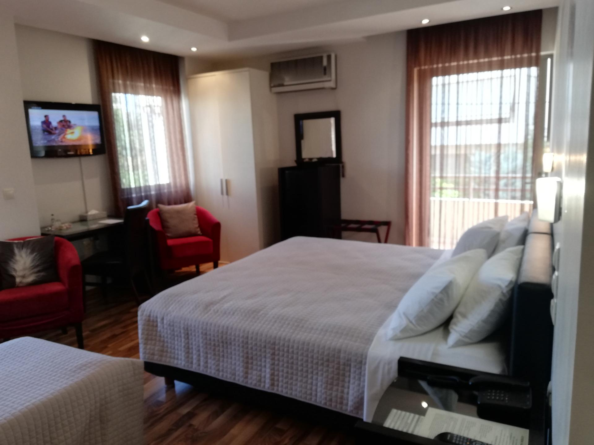 Double bed at Athens Habitat Hotel
