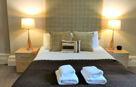 Bed at Rosslyn Terrace Apartment