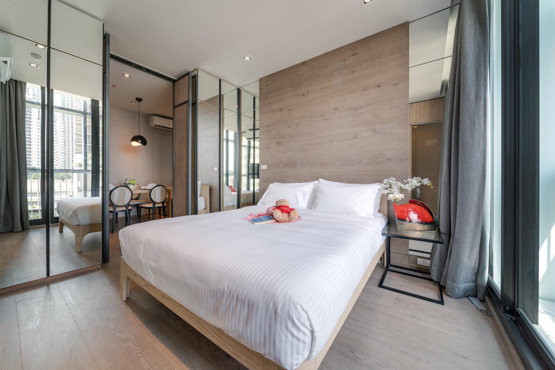 Bed at EM District Apartments