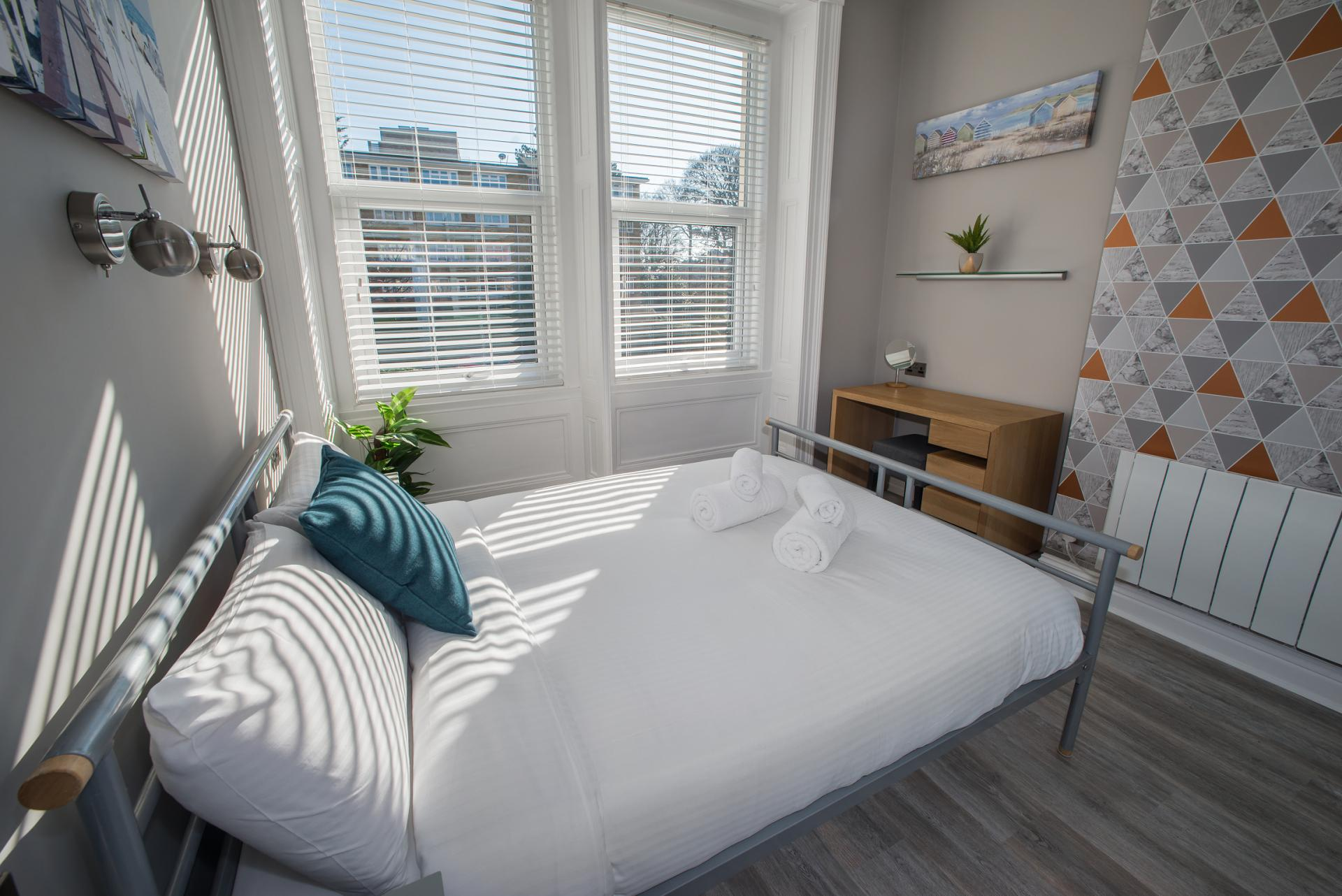 Bed at Chine Garden Apartment