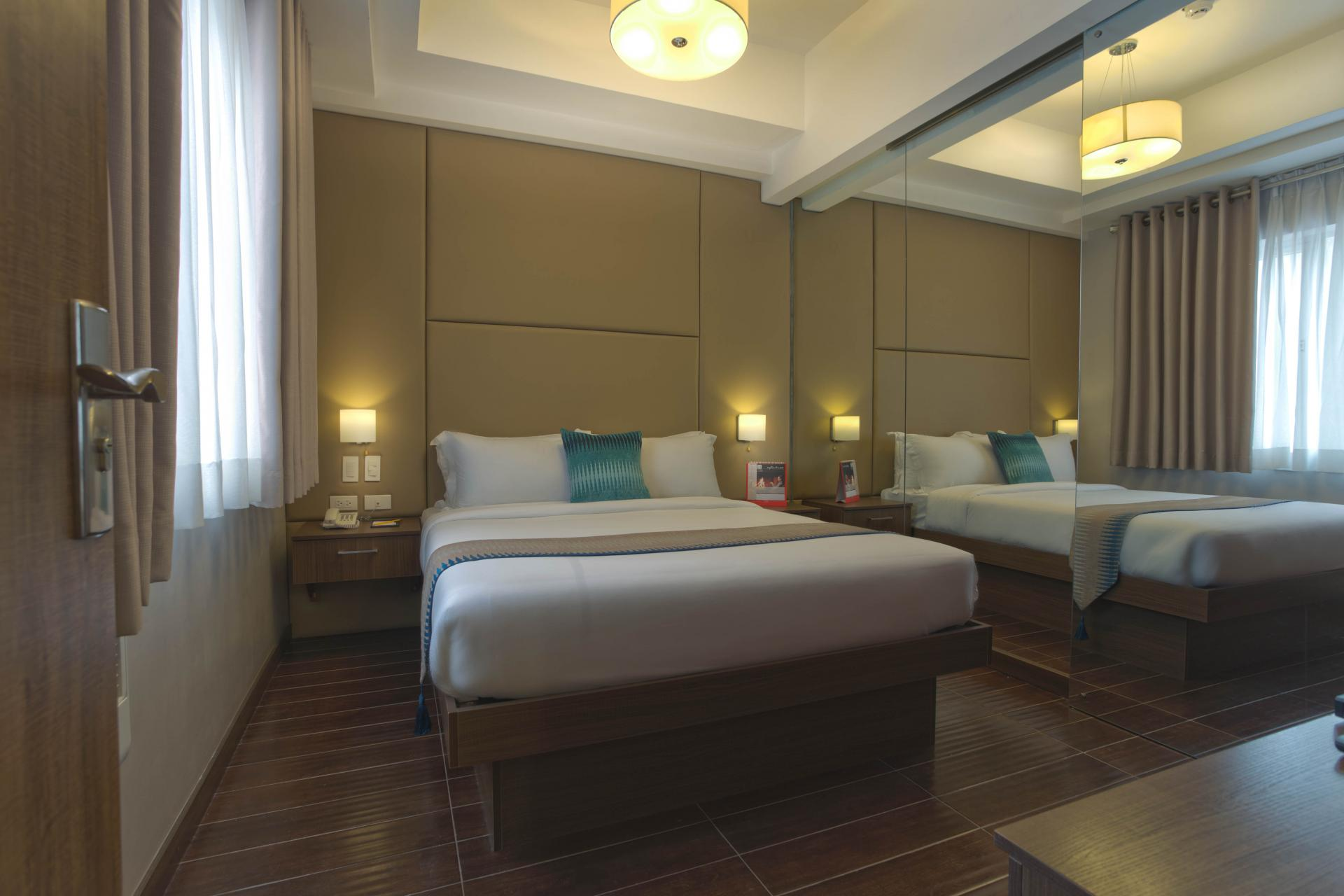 Bedroom at Valero Grand Suites