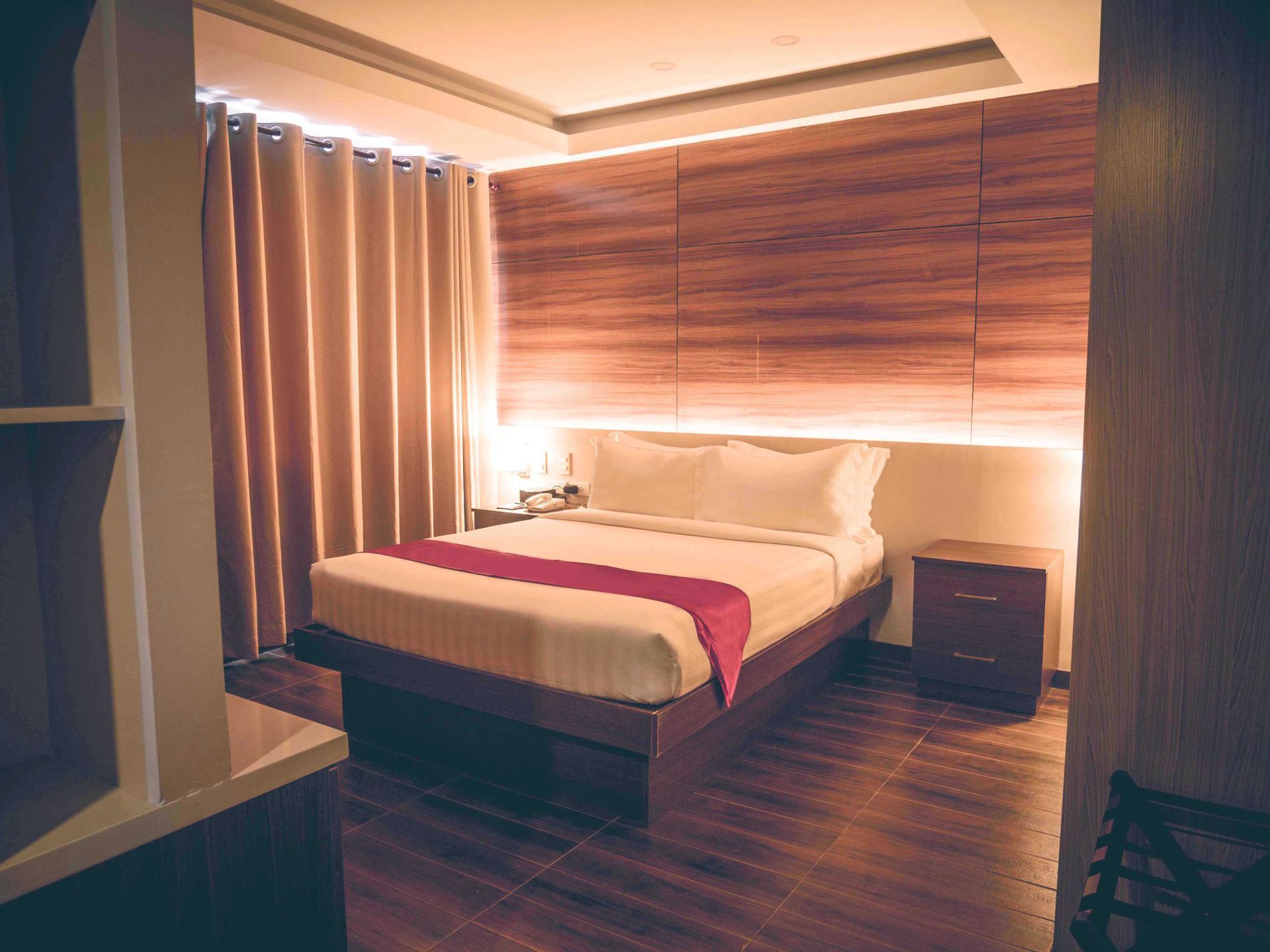 Bed at Valero Grand Suites