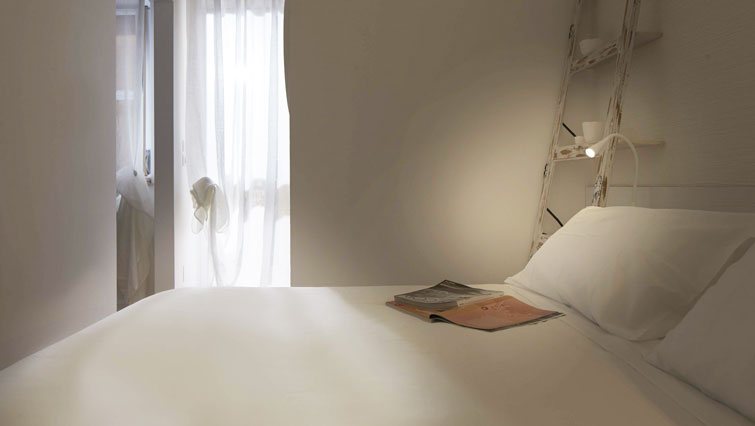 Bed at Suites Serviced Apartments