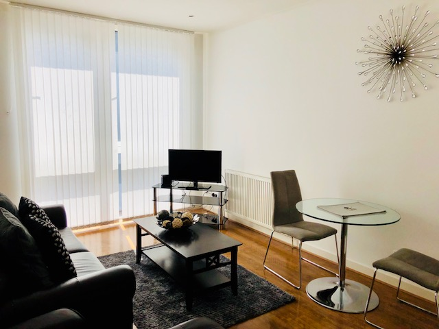 Living room at Oswald Street Serviced Apartments