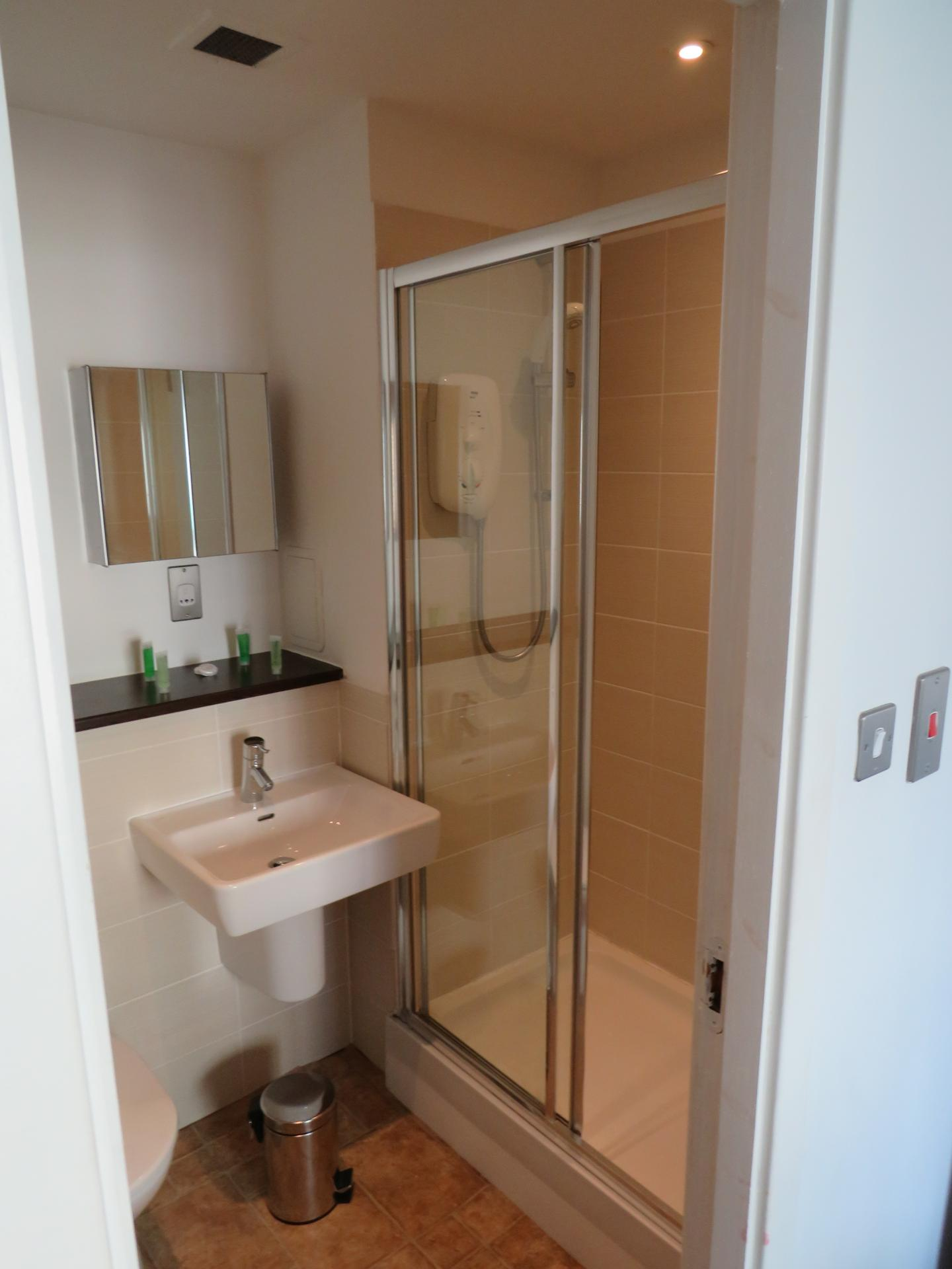 Shower at Oswald Street Serviced Apartments