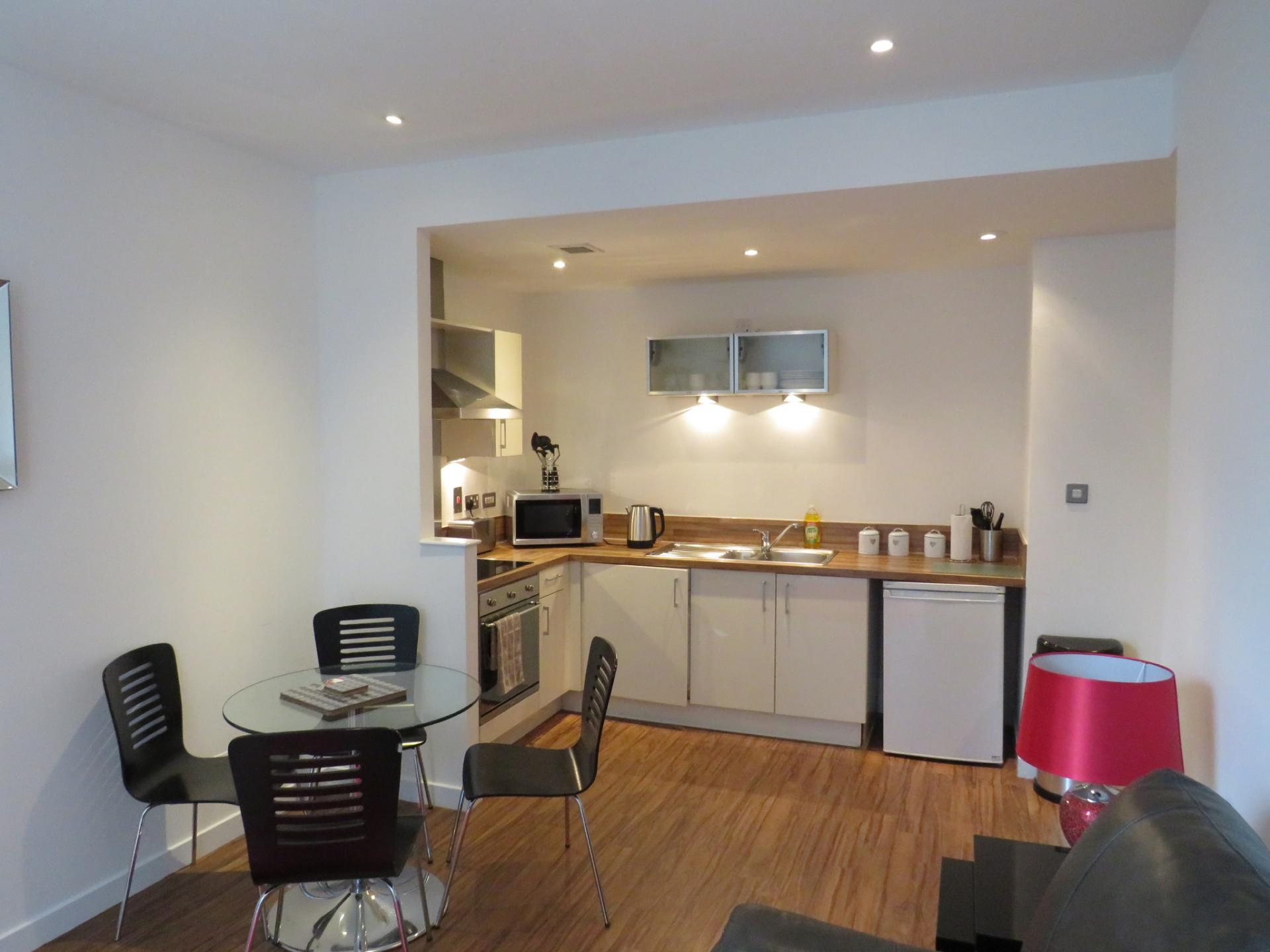 Open-plan kitchen area at Oswald Street Serviced Apartments