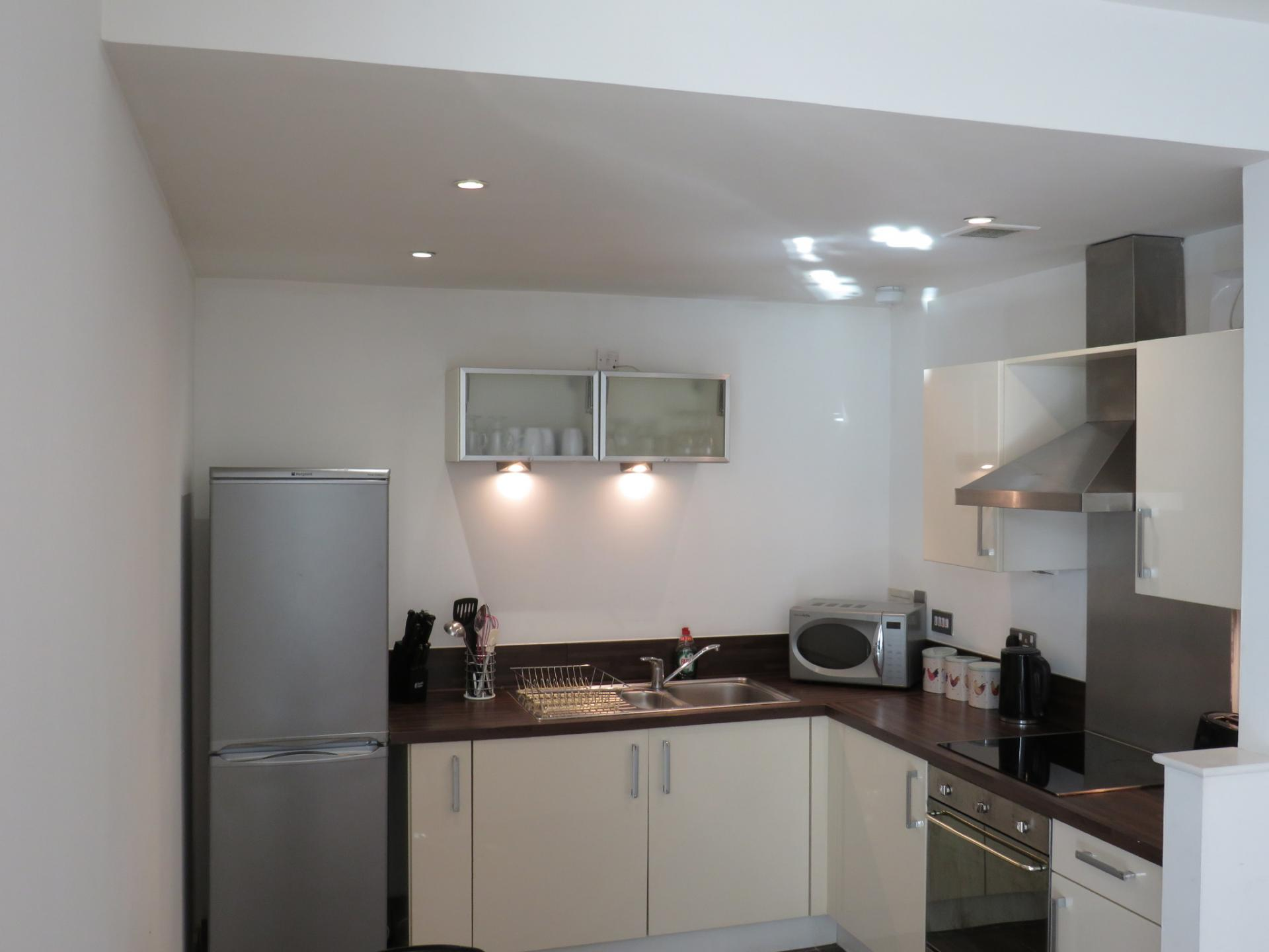 Kitchen at Oswald Street Serviced Apartments