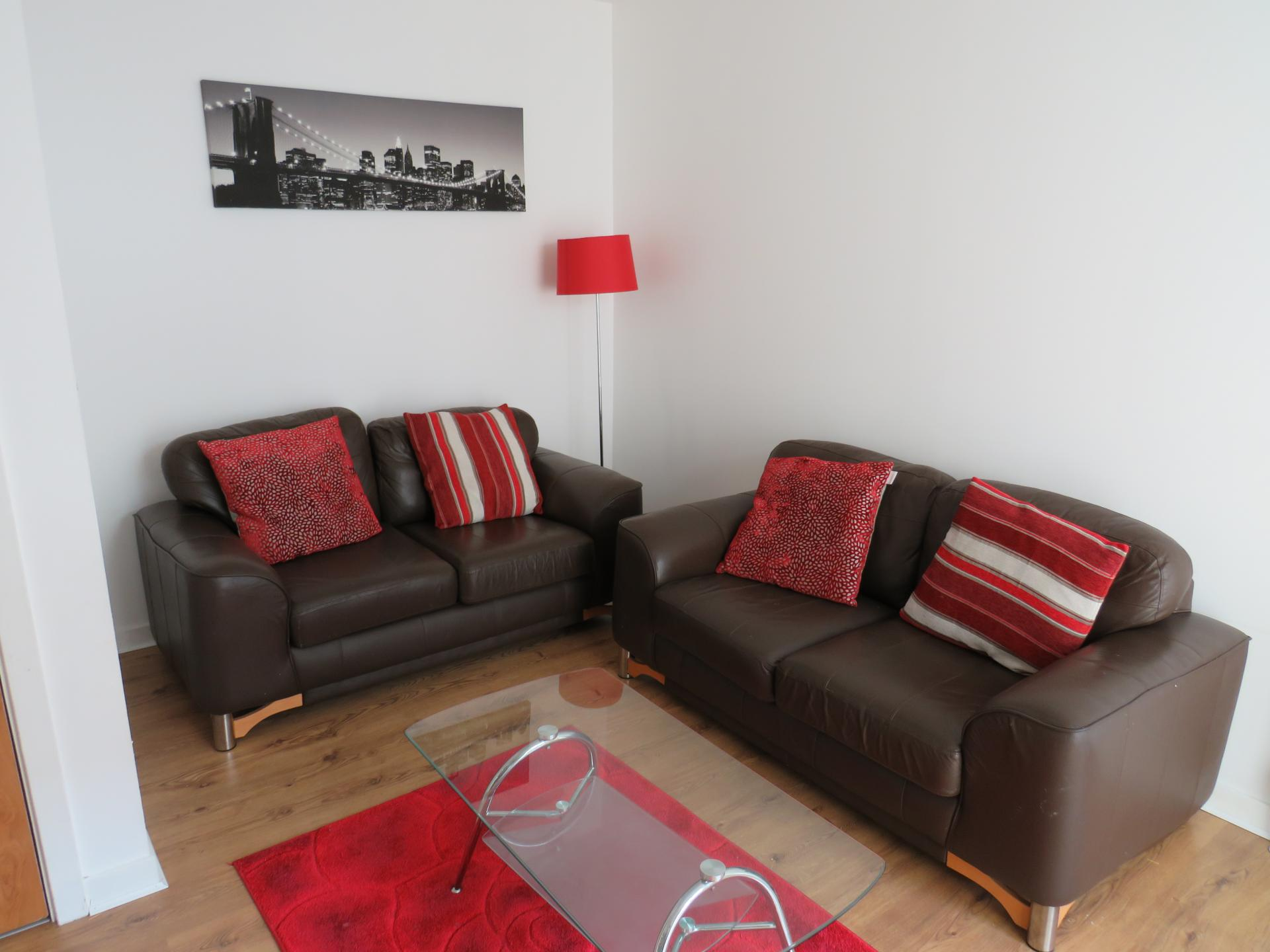 Sofa at Oswald Street Serviced Apartments