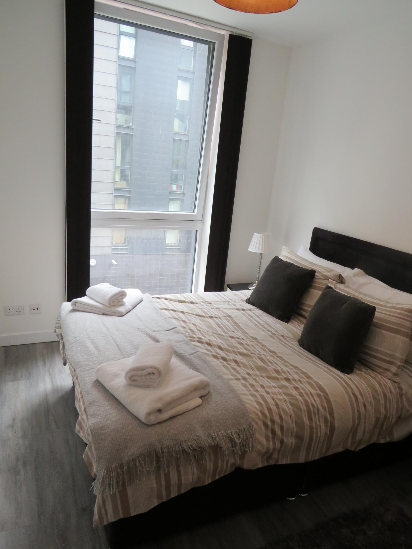 Double bed at Oswald Street Serviced Apartments