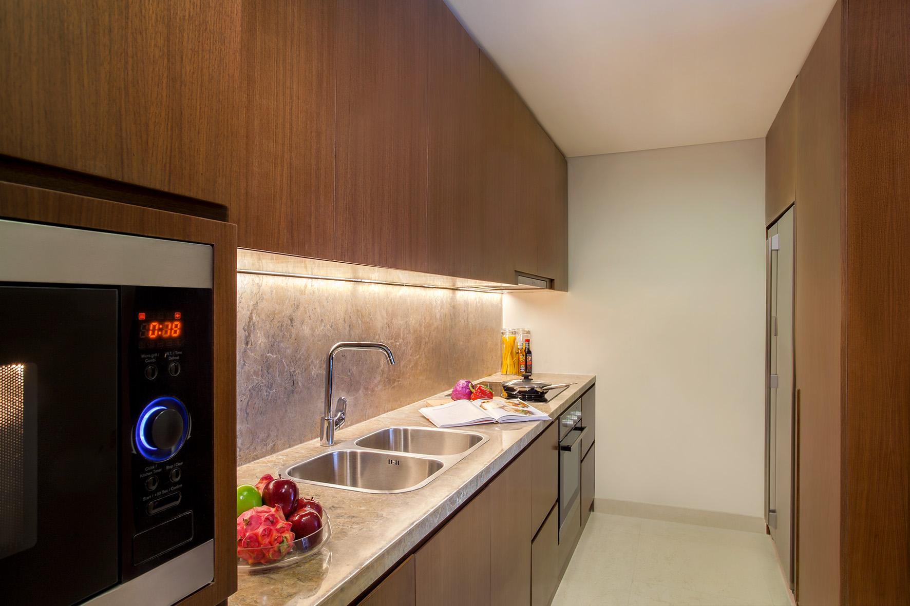 Equipped kitchen at Ascott Sudirman Jakarta Apartments