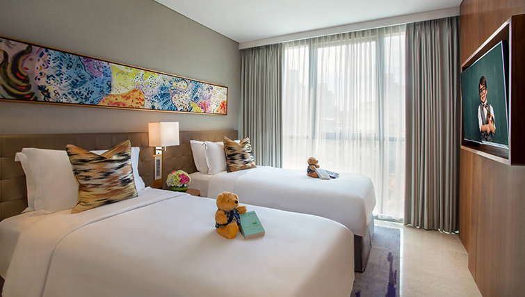 Twin beds at Ascott Sudirman Jakarta Apartments