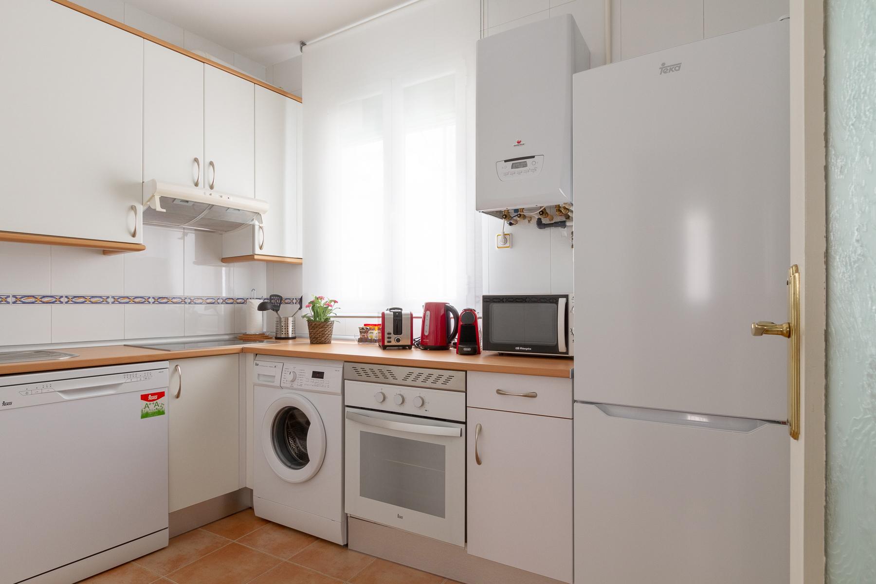 Kitchen at Fernan Gonzalez Apartments