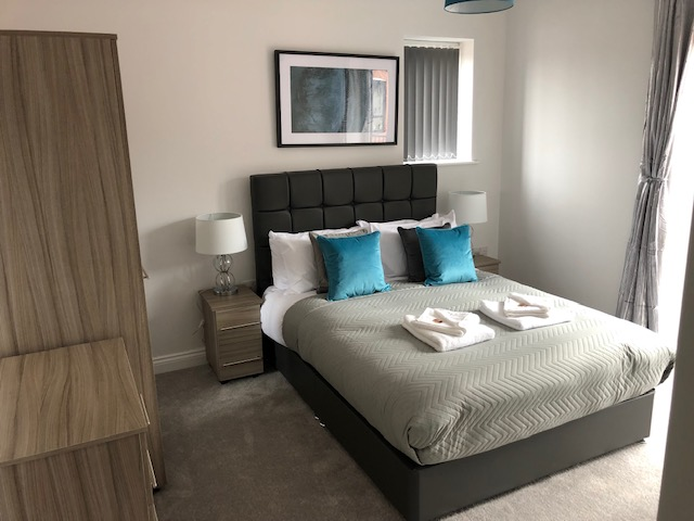 Double bed at William Street Apartments