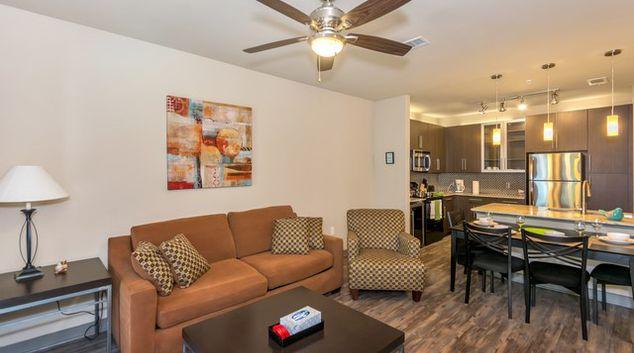 Living Room at Elan City Lights Apartment