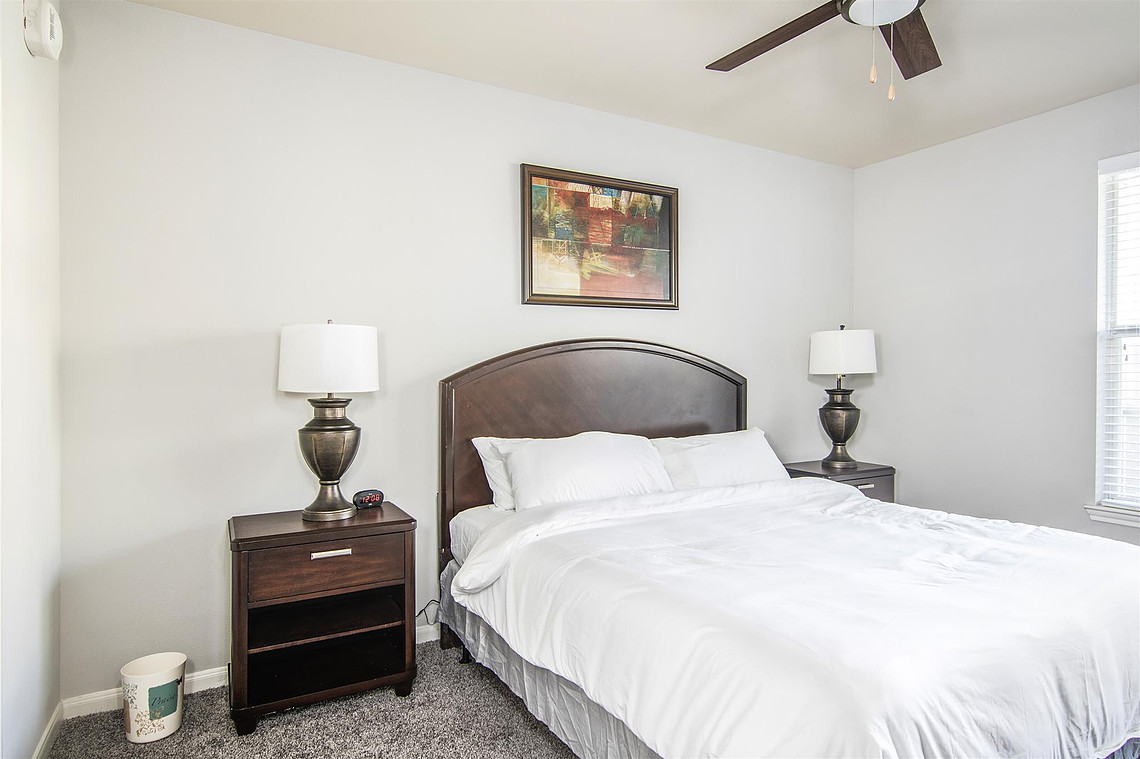 Bedroom at Vibe Medical District Apartment