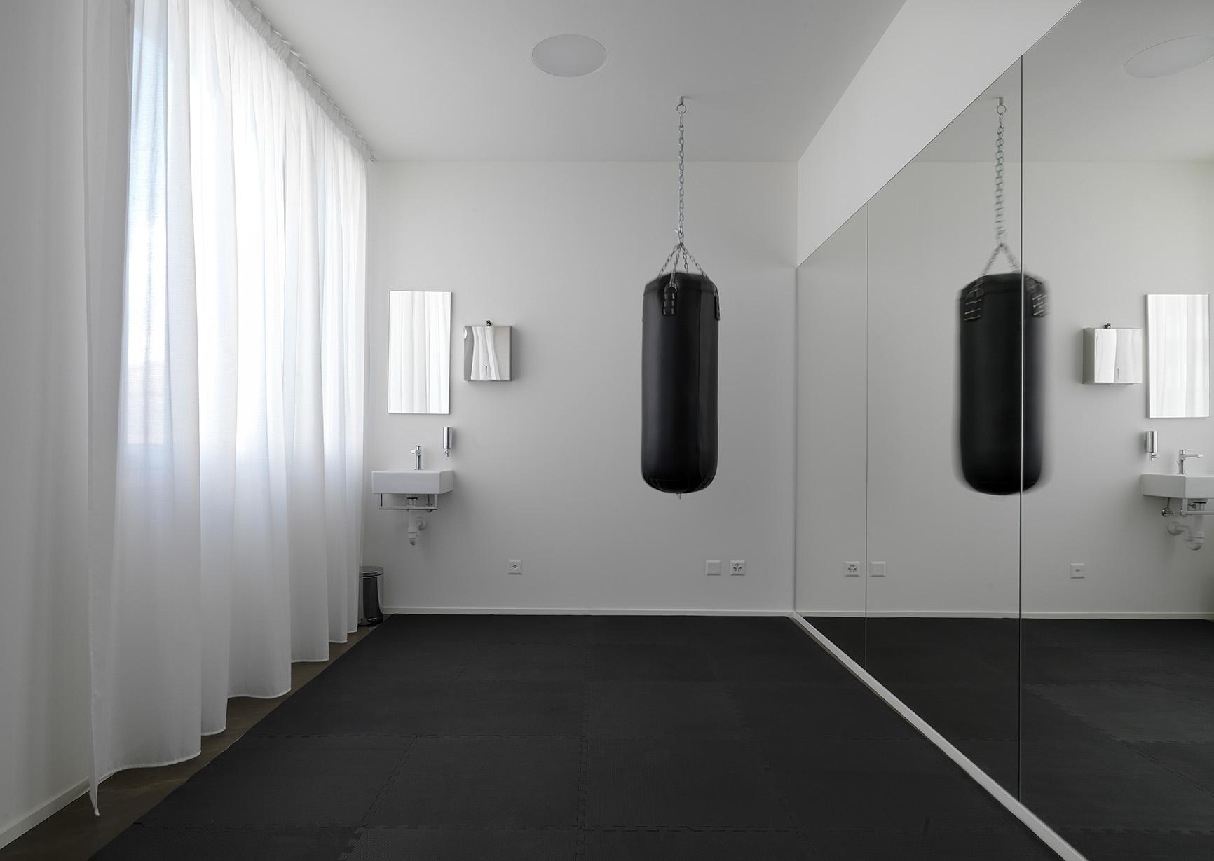 Gym area at Smart Living Lugano Apartments