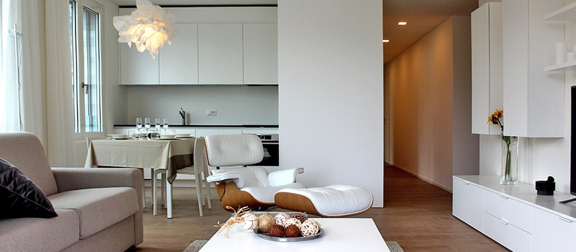 Open-plan living area at Smart Living Lugano Apartments
