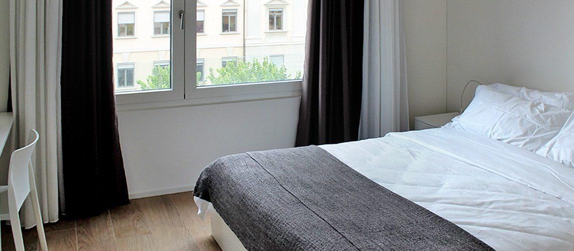 Bedroom at Smart Living Lugano Apartments