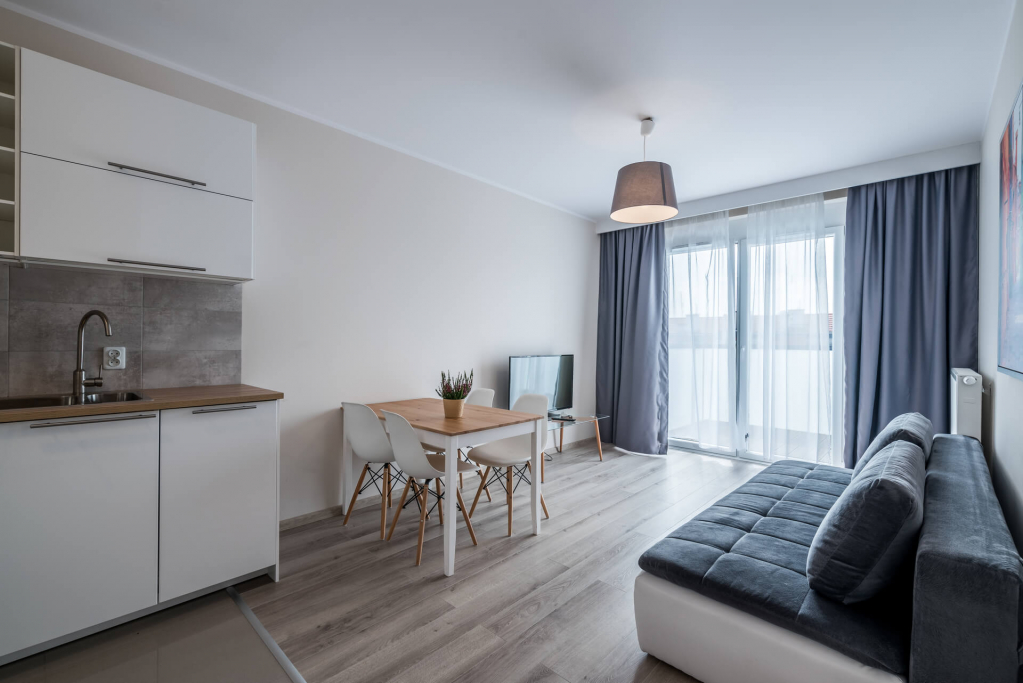 Open-plan living area at Sikorskiego Apartments