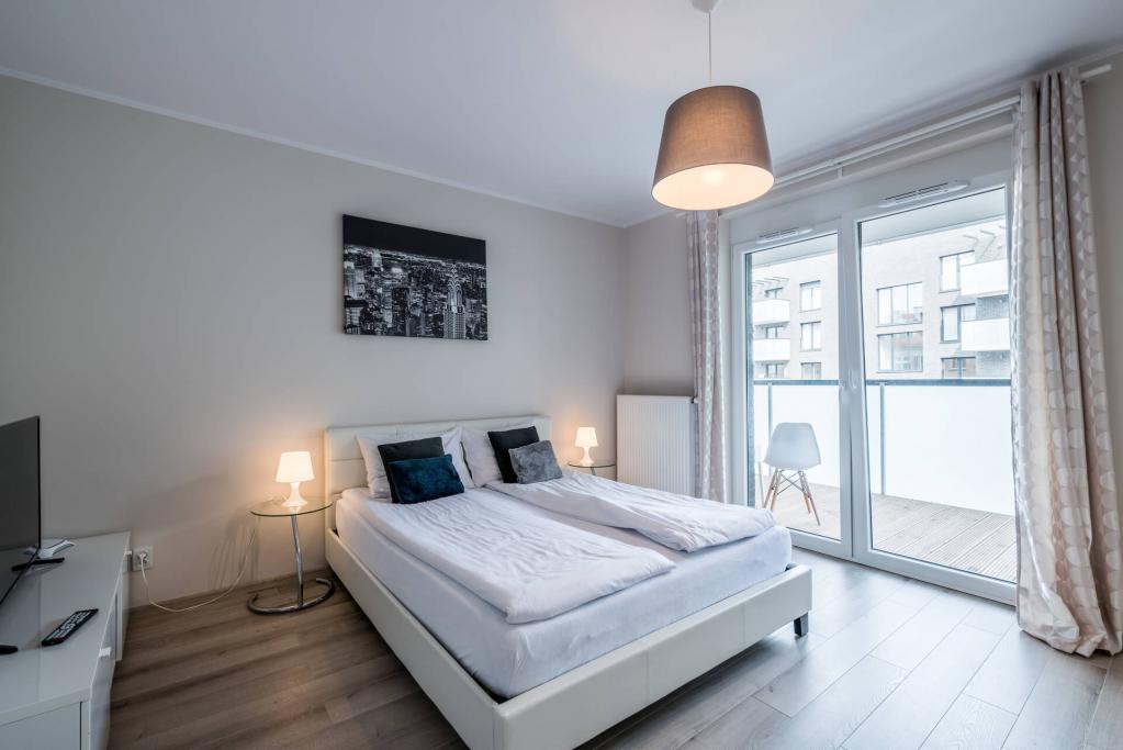 Brigt bedroom at Sikorskiego Apartments