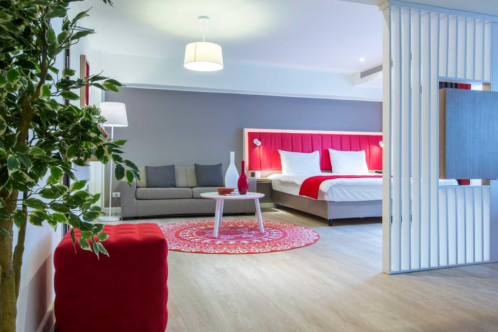 Stylish bedroom at Park Inn Bucharest Residence