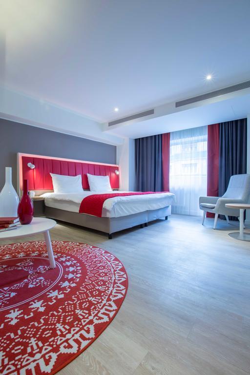 Bright bedroom at Park Inn Bucharest Residence