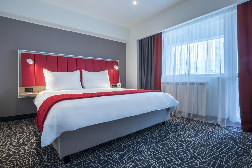 Bedroom at Park Inn Bucharest Residence