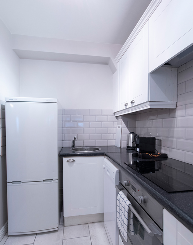 Fully equipped kitchen at Oaks Apartment