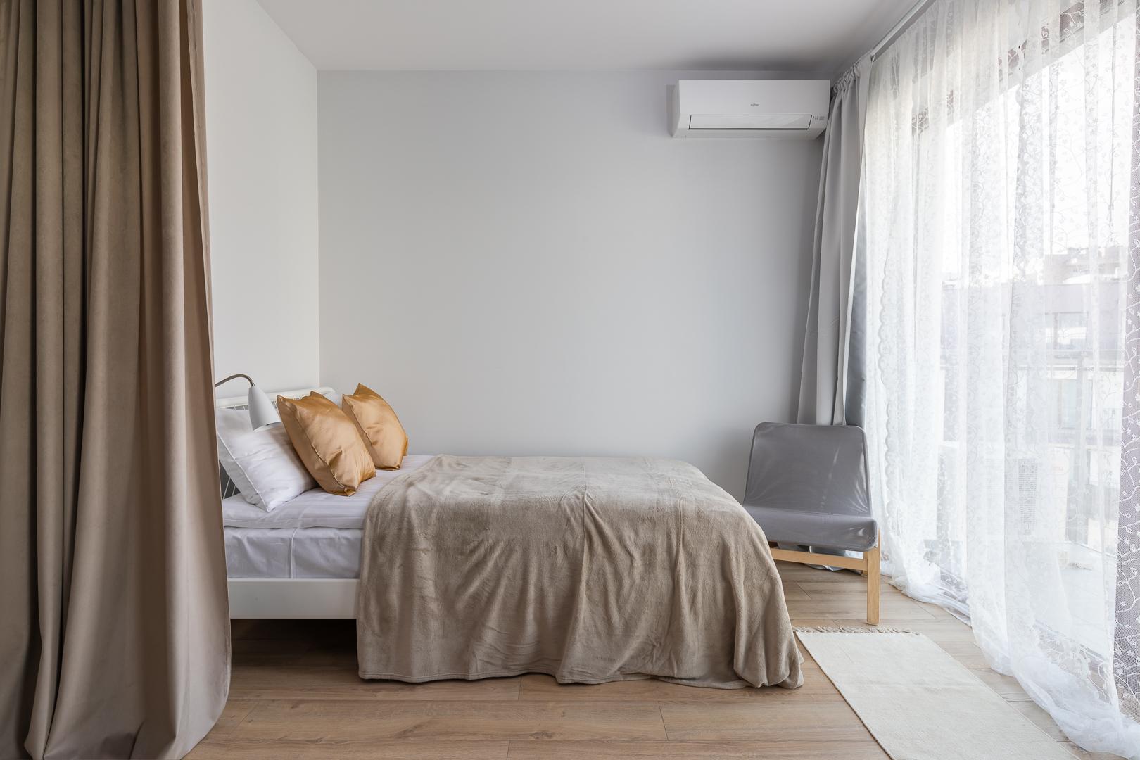 Bright bedroom at Burakowska Apartments