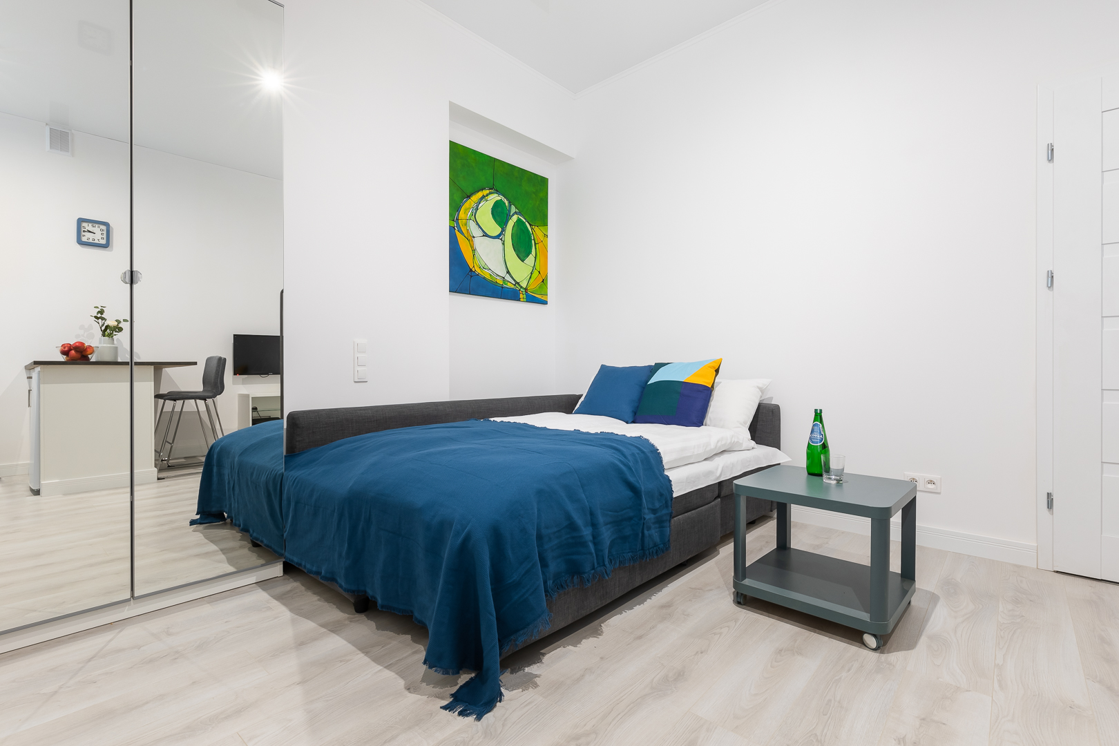 Blue bed at Wspolna Apartments